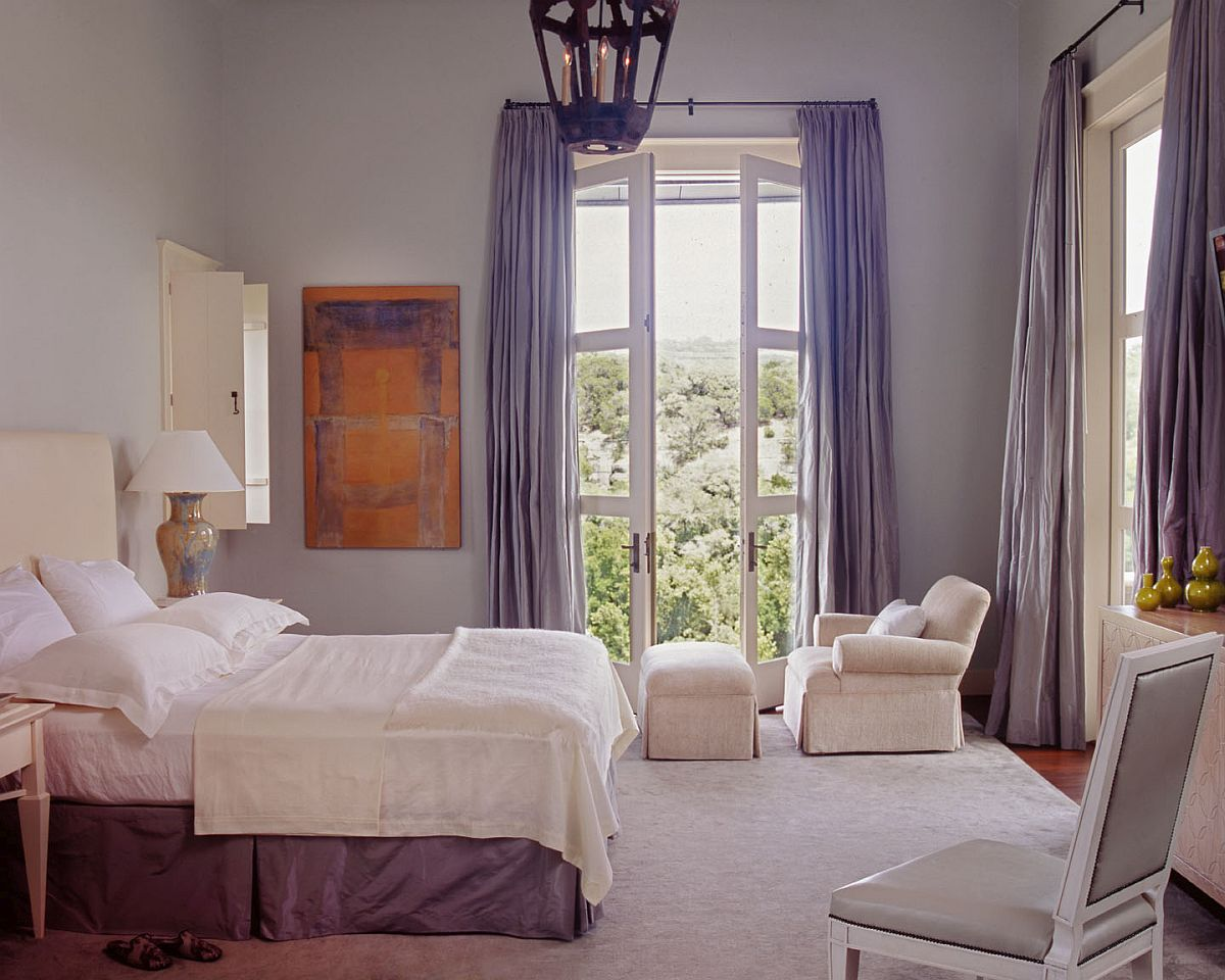 Bedroom-in-white-with-drapes-in-light-blue-and-ample-natural-light-89106