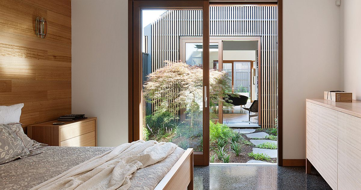 Bedroom of the house flows into the courtyard and offers a view of the home on other side
