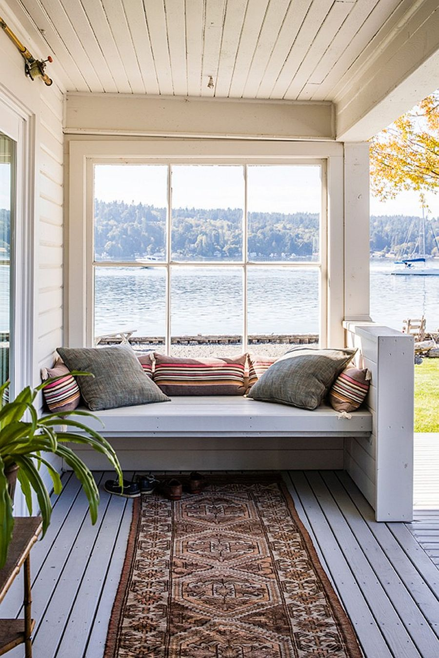 Bench on the wooden patio of the island home with fabulous veiws just beyond