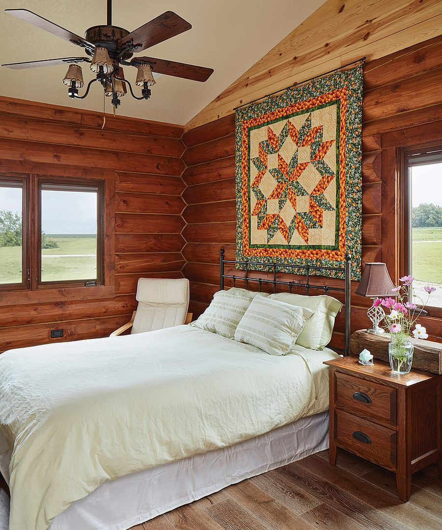 Bespoke art work makes the biggest impact in this small rustic bedroom with lovely views
