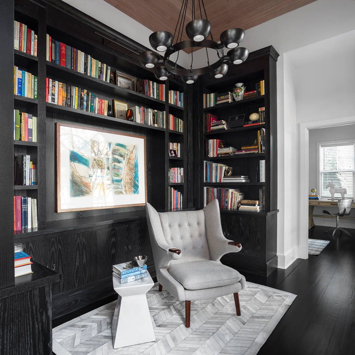 Black in the living room becomes that much more prominent when coupled with black flooring