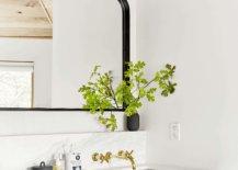 Black-mirror-in-a-refreshing-white-bathroom-by-Emily-Henderson-37183-217x155