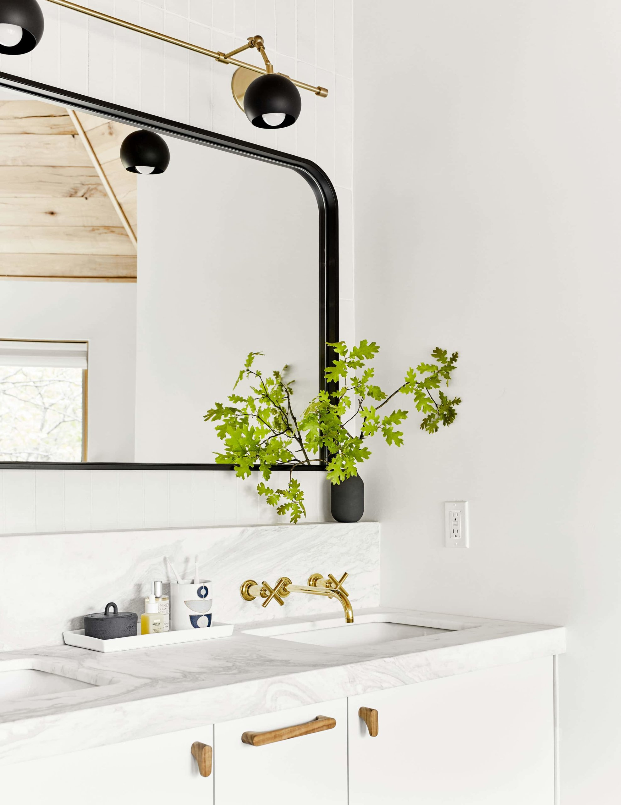 Black mirror in a refreshing white bathroom by Emily Henderson