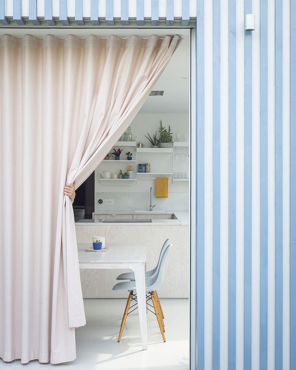 Blue and white striped timber extension along with patel pink curtain