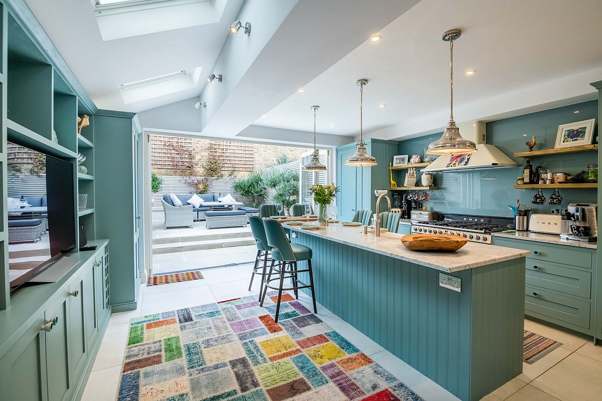 Blue links the kitchen with the rear yard and creates a sense of continuity