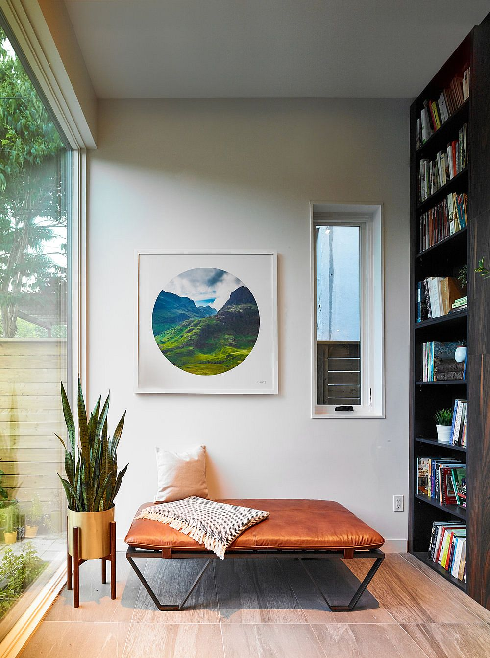 Bookshelf and lovely reading space with a view of the backyard