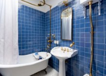 Brass-accents-add-metallic-sparkle-to-the-slightly-eclectic-bathroom-in-blue-and-white-22457-217x155