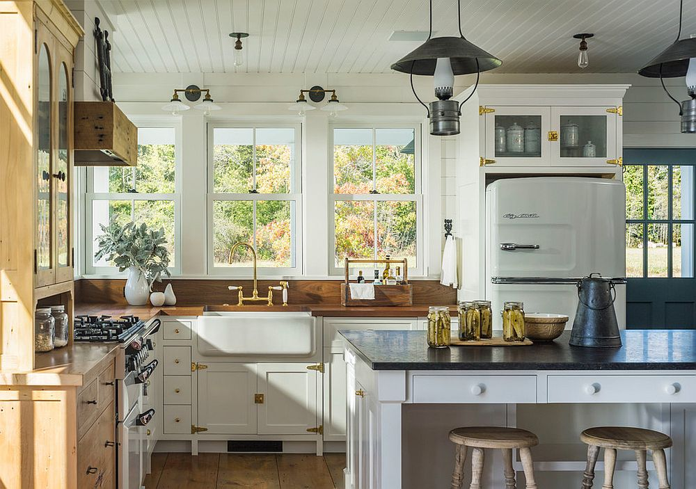 Brass fixtures and hardware give the wood and white kitchen a brighter visual appeal