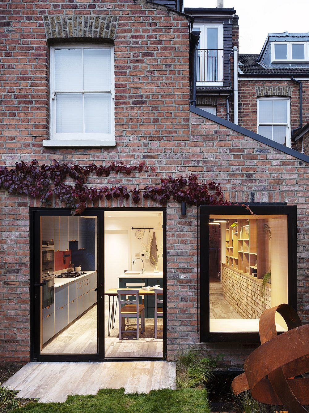 Brick and Glass extension of the Almington Street House gives the home new storage solutions