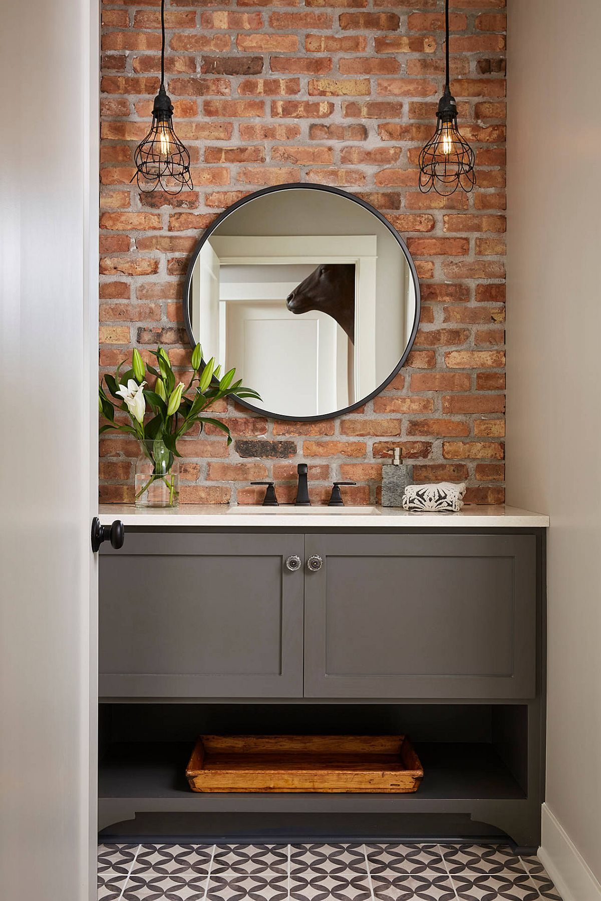 Brick, gray and white combined beautifully in the small modern bathroom