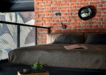 Brick-wall-and-smart-metal-mesh-offer-ample-textural-contrast-to-this-small-industrial-bedroom-70193-217x155