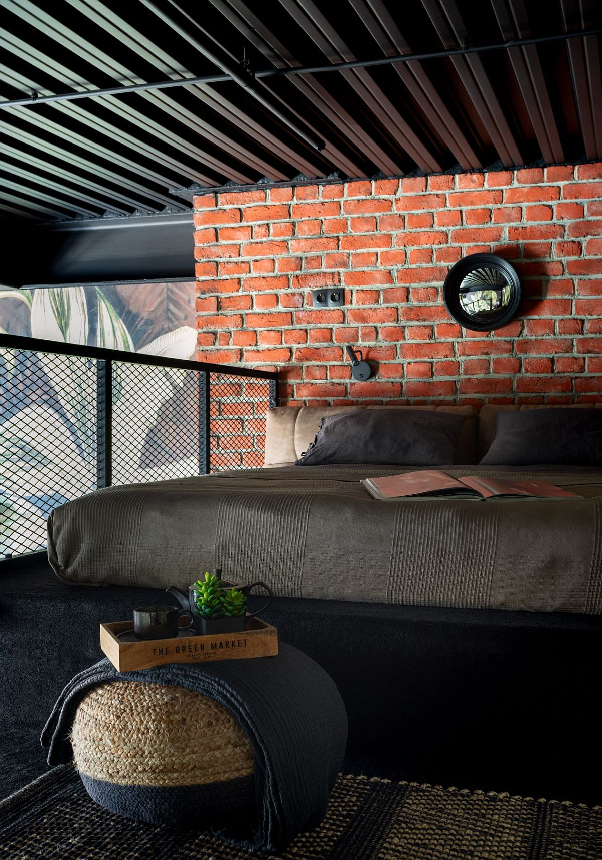 Brick-wall-and-smart-metal-mesh-offer-ample-textural-contrast-to-this-small-industrial-bedroom-70193