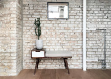 Brick-wall-backdrop-in-the-apartment-is-preserved-and-enhanced-to-add-texture-to-the-interior-41524-217x155