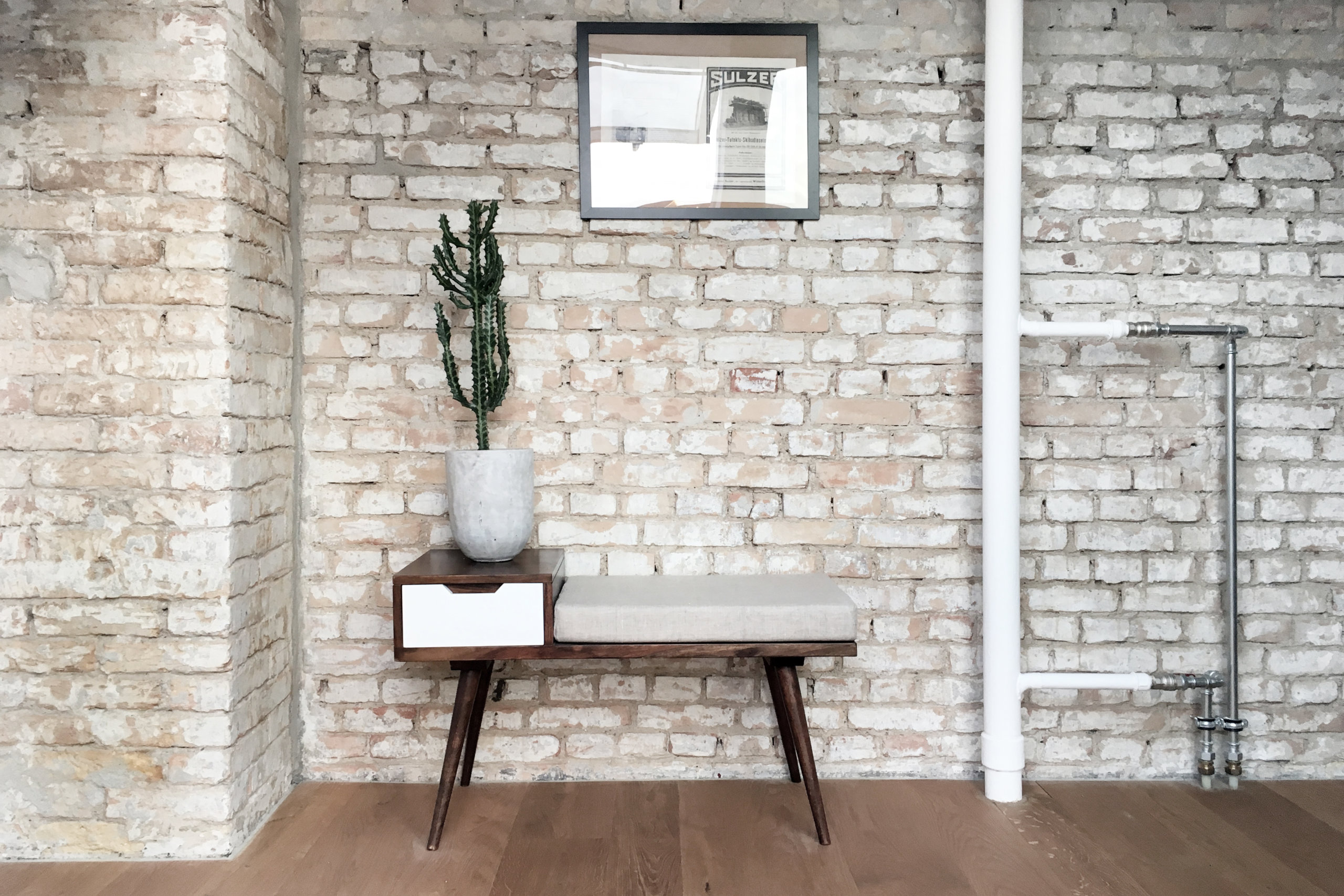 Brick-wall-backdrop-in-the-apartment-is-preserved-and-enhanced-to-add-texture-to-the-interior-41524-scaled