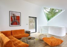 Bright-Togo-Sofa-in-orange-adds-color-to-the-neutral-space-in-white-and-wood-55174-217x155