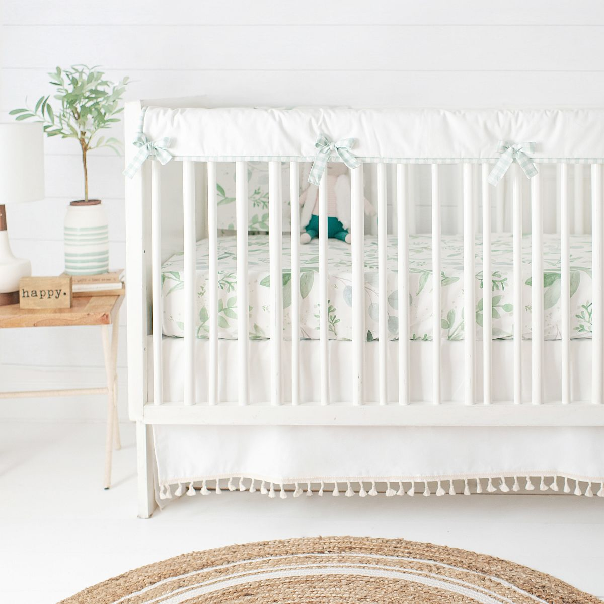 Bring the right crib into the farmhouse style nursery with white and wood color duo