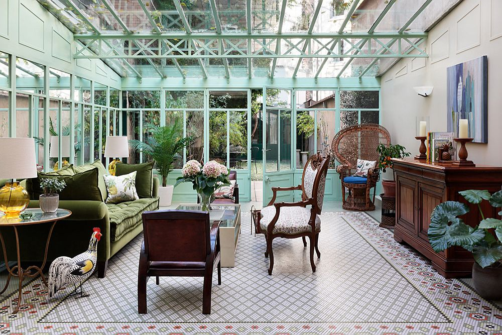 Ceiling in glass and blue frame give this eclectic sunroom a sense of uniqueness