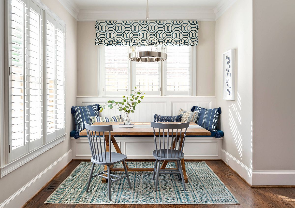 Chairs-in-bluish-gray-and-striped-pillows-bring-color-to-this-small-beach-style-dining-room-40076