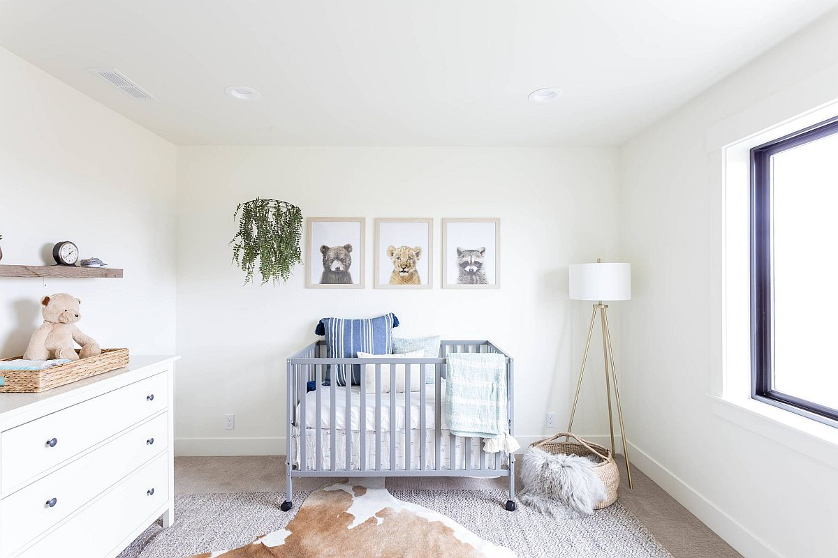 Chic farmhouse style nursery with more white than wood making a statement