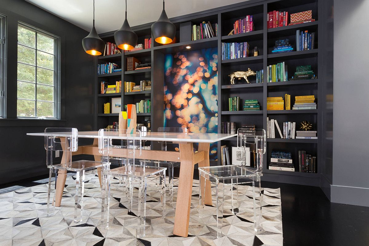 Colorful modern dining room with acrylic chairs, Tom Dixon pendants and a glossy black floor