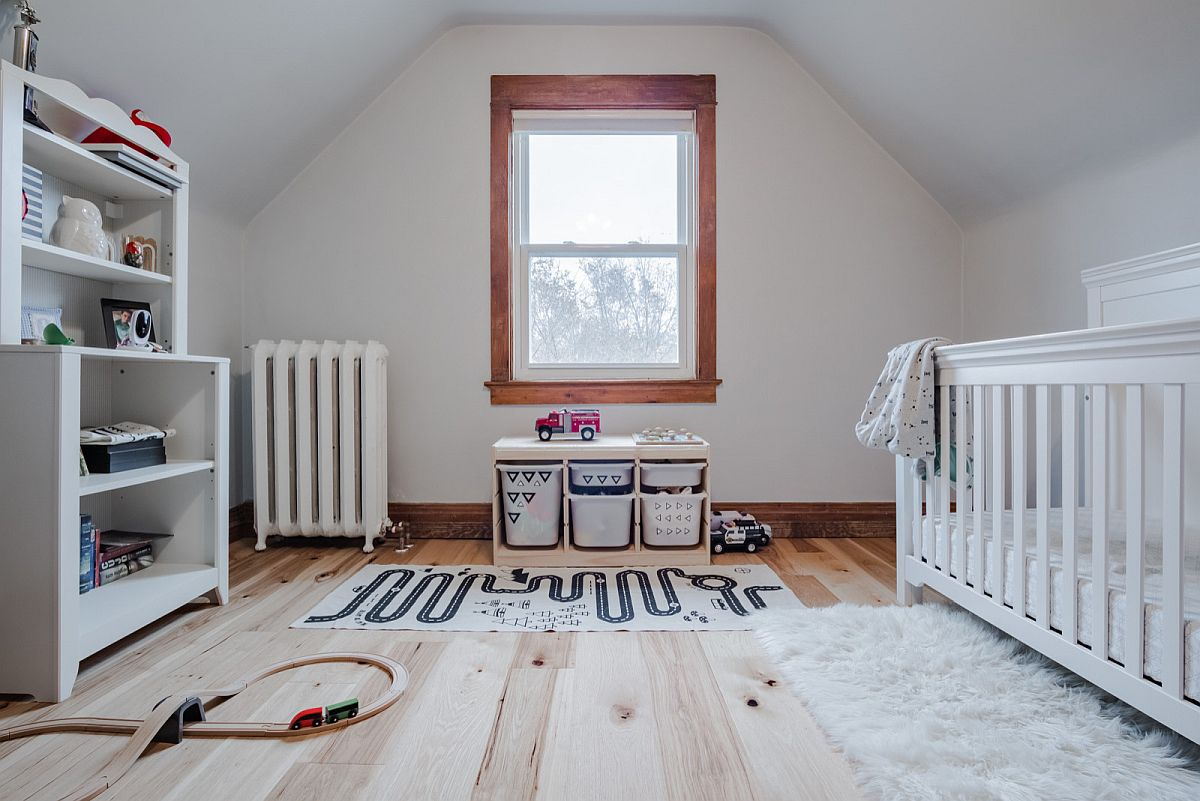 Combine white with light gray and wood for a light-filled and fabulous nursery