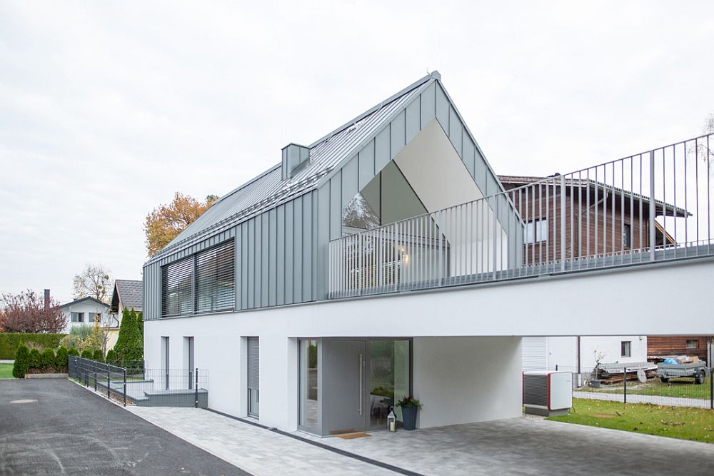 Common garage and garden area creates separation between both the houses