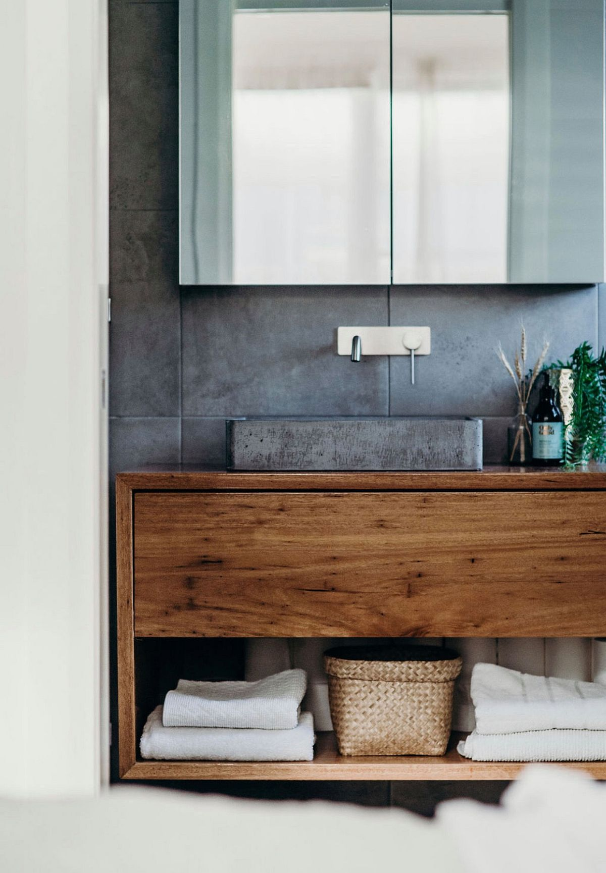 Concrete-accent-wall-for-the-bathroom-in-white-with-a-wooden-vanity-89550