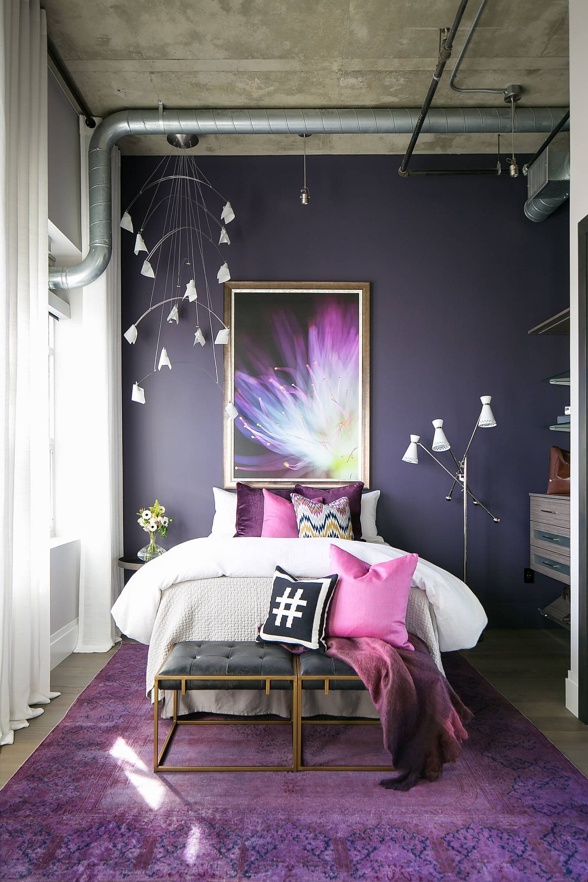 Concrete-ceiling-and-exposed-duct-pipes-bring-industrial-beauty-to-this-colorful-bedroom-in-violet-64727
