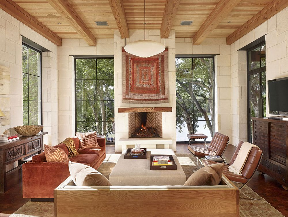 Contemporary living room of Texas home with gorgeous fireplace and captivating views of Lake Austin