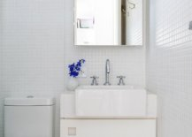 Corner-vanity-for-the-small-monochromatic-bathroom-in-white-with-ample-natural-light-47284-217x155