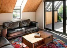 Cozy-attic-style-living-area-with-comfortable-seating-wooden-ceiling-and-a-colorful-rug-33343-217x155