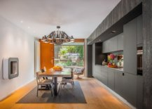 Creating-a-kitchen-and-dining-area-with-white-walls-gray-cabinet-and-wooden-floor-that-adds-visual-warmth-92424-217x155
