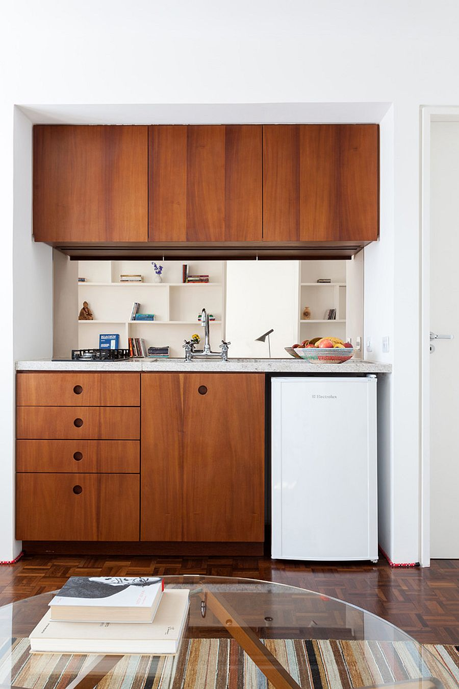 Creating that perfect ultra-small kitchen inside the tiny studio apartment with modern, space-savvy appeal