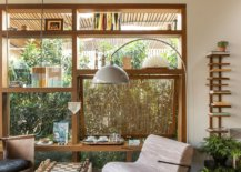 Cusom-wooden-shelf-and-glass-walls-give-the-family-room-a-bespoke-look-41448-217x155