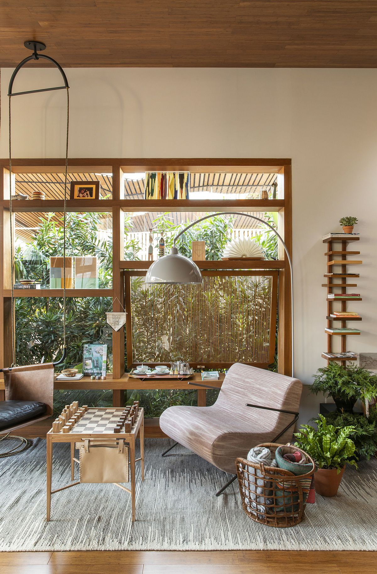 Cusom-wooden-shelf-and-glass-walls-give-the-family-room-a-bespoke-look-41448