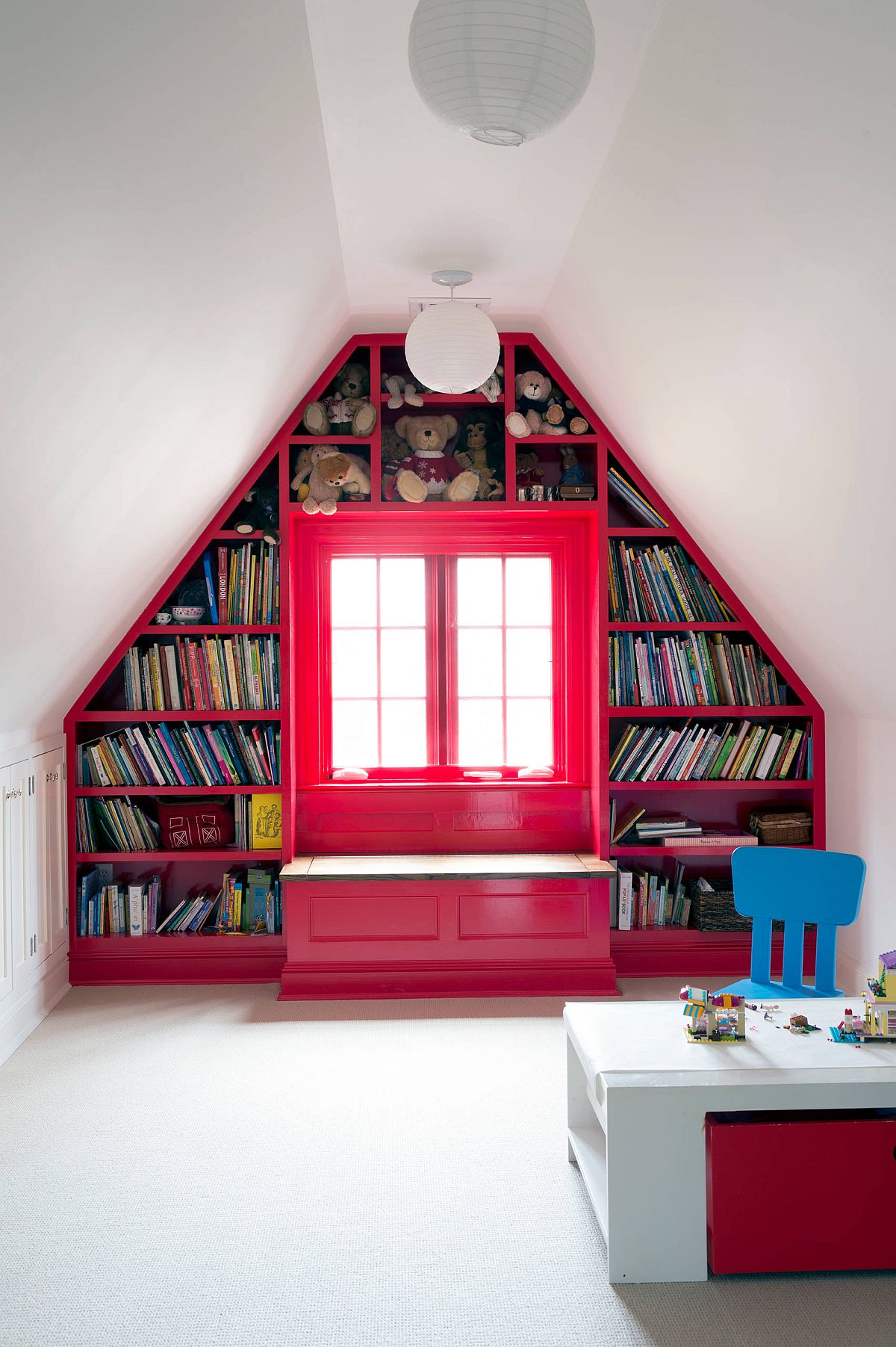 Custom bookshelf and storage area for all your kids' needs inside the lovely contemporary attic playroom