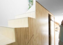 Custom-storage-space-under-the-plywood-staircase-maximizes-total-square-footage-of-the-apartment-80951-217x155