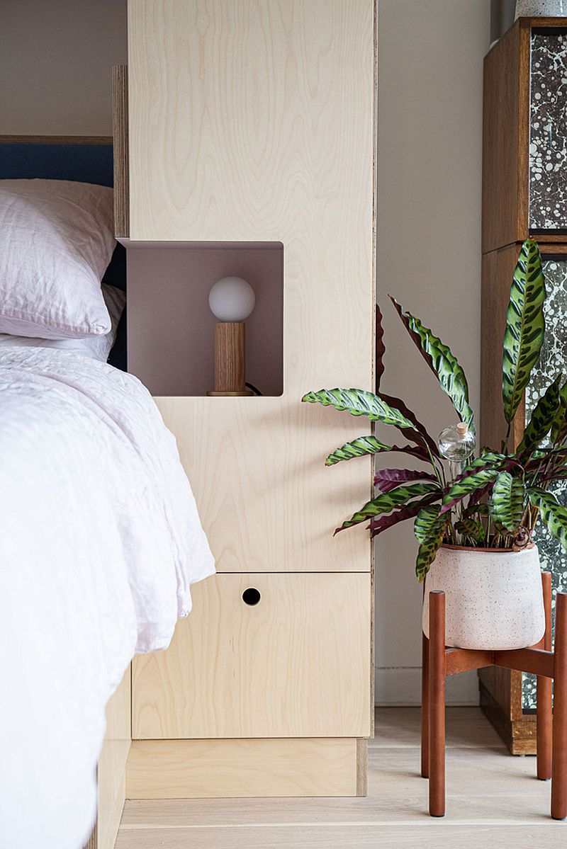 Custom wooden wall unit with smart niches contains the bedside lamps
