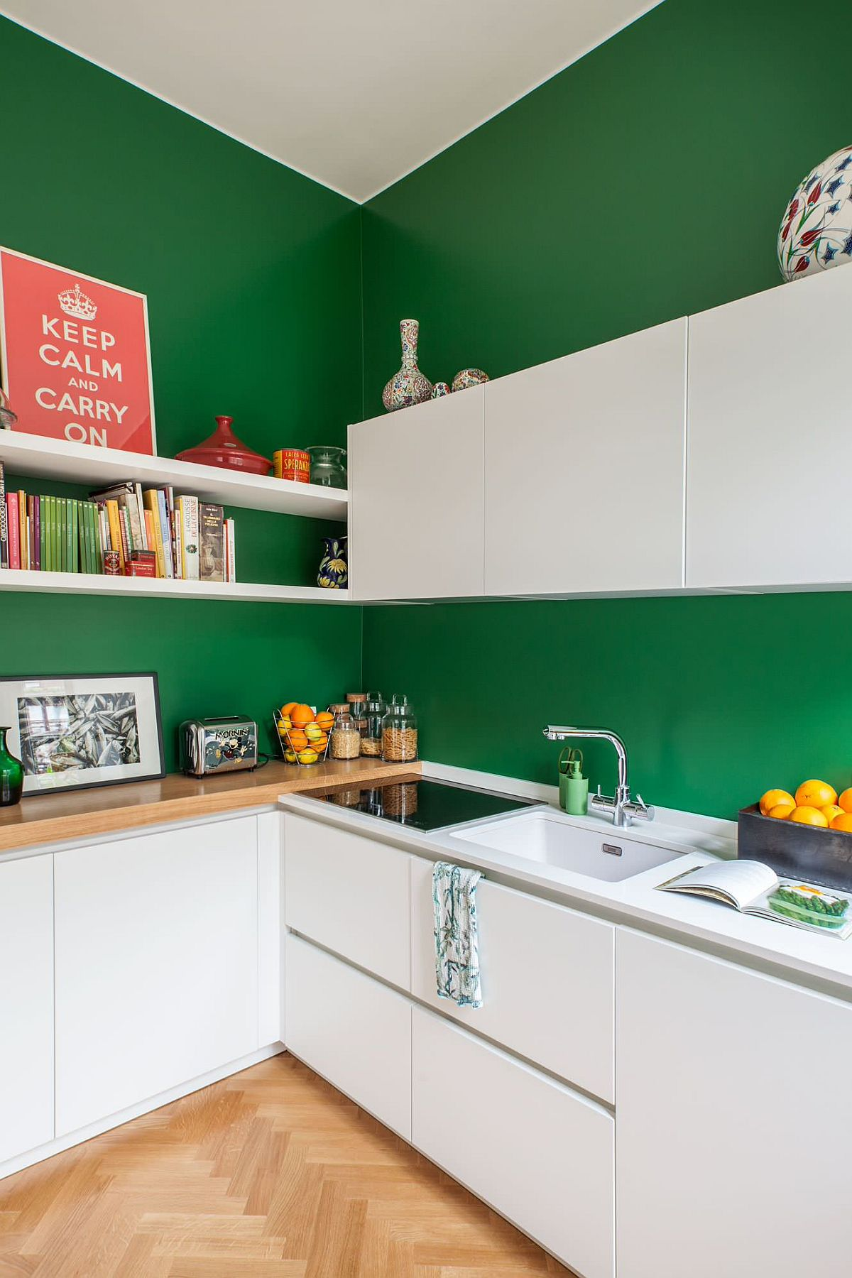 Dark green walls for the small Scandinavian style kitchen with white cabinets