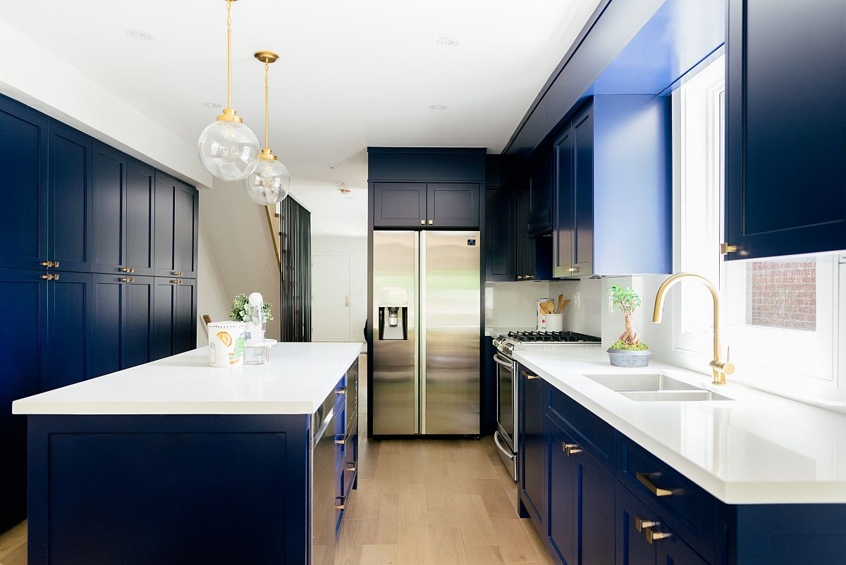 Dashing white and navy blue kitchen with brass handles and fixtures