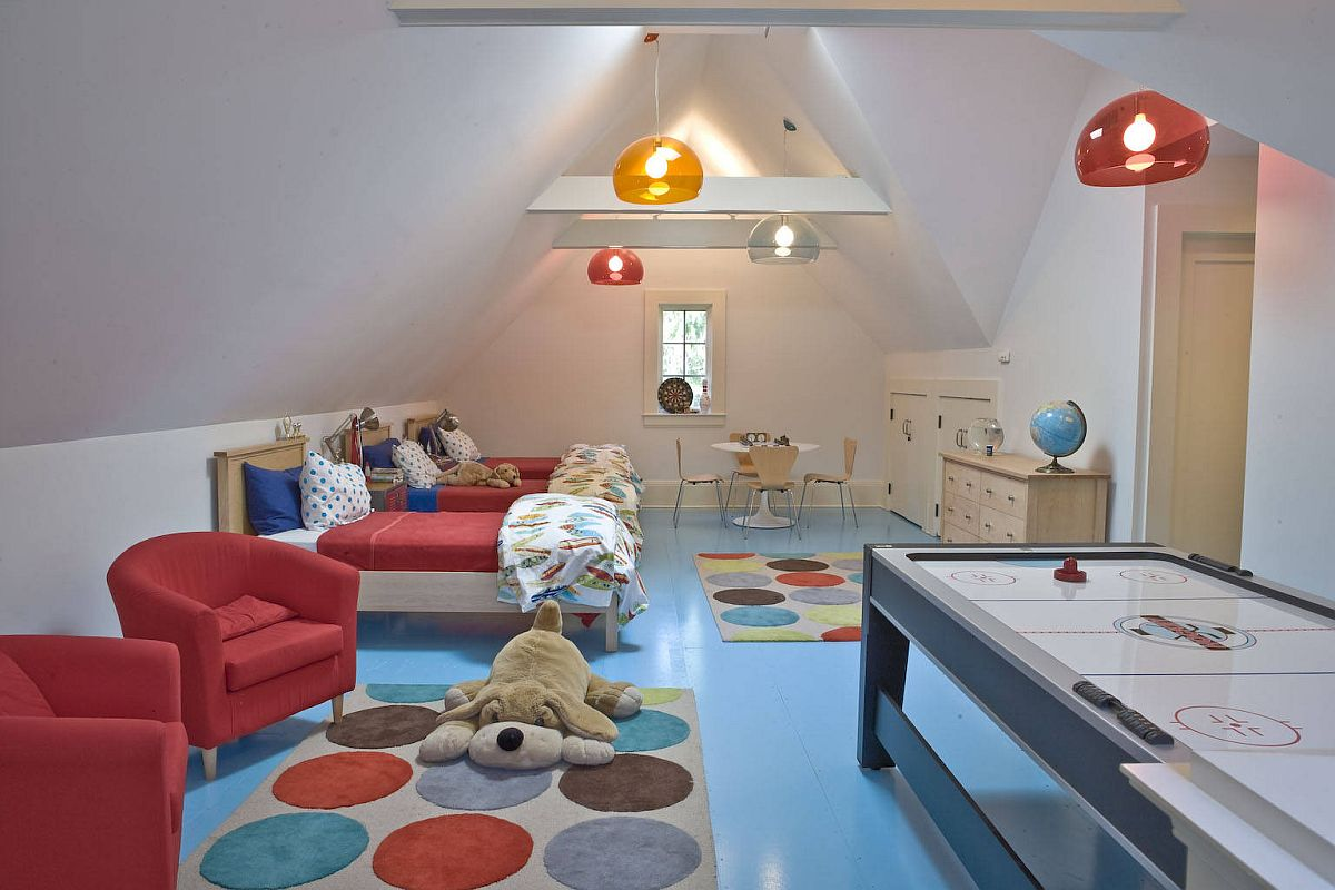 Decor, flooring and pendant lights add multiple colors to this gorgeous attic playroom that is just so refreshing