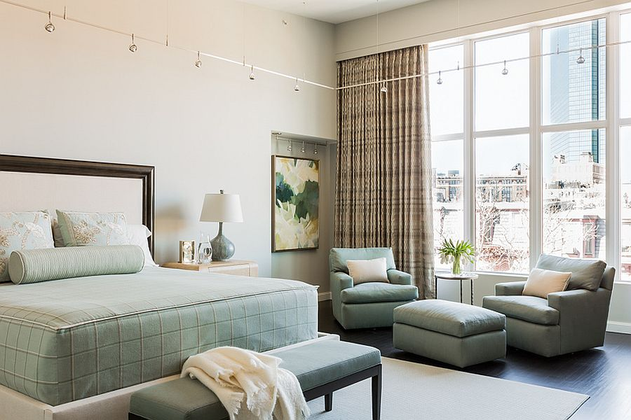 Decor in pastel hue along with bedding in matching colors for the light-filled master bedroom