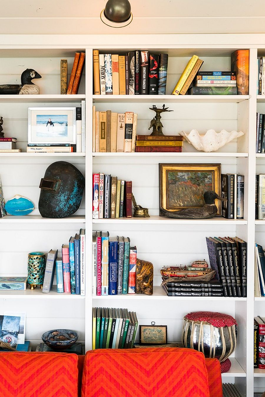 Decorating bookshelves inside the modern coastal home with books and more