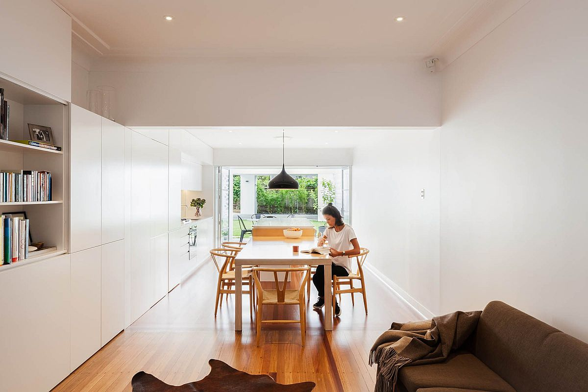 Dining space inside the house feels like a natural extension of the kitchen island