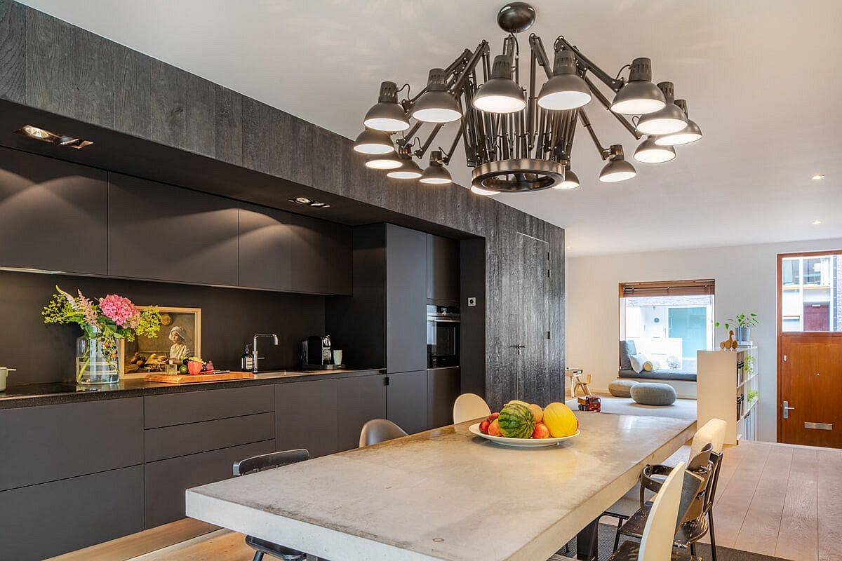 Dark gray and black paint a picture of sophistication in this Amsterdam kitchen