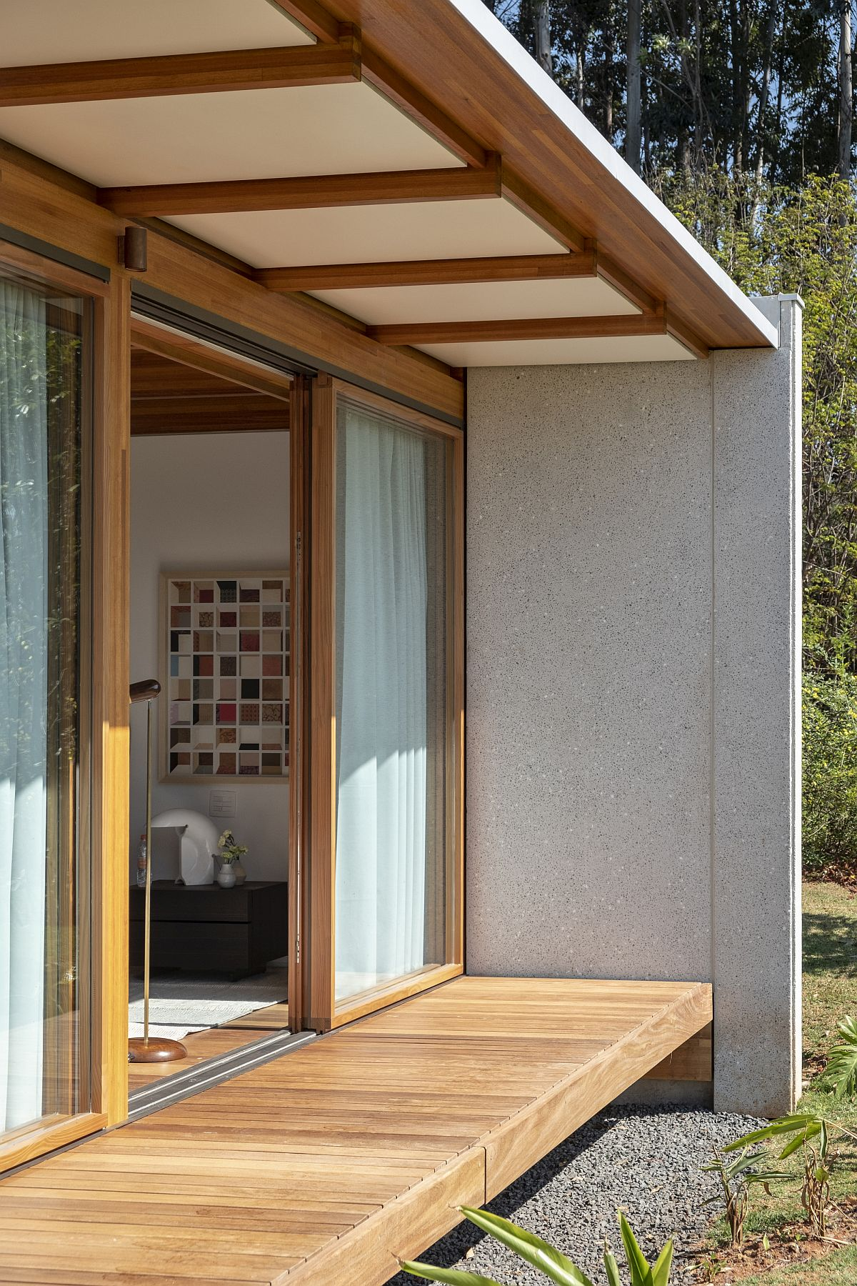 Drapes coupled with sliding doors allow those inside to switch between privacy and unabated views