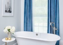 Drapes-in-blue-add-color-to-this-bathroom-in-white-with-a-modern-minimal-look-29237-217x155