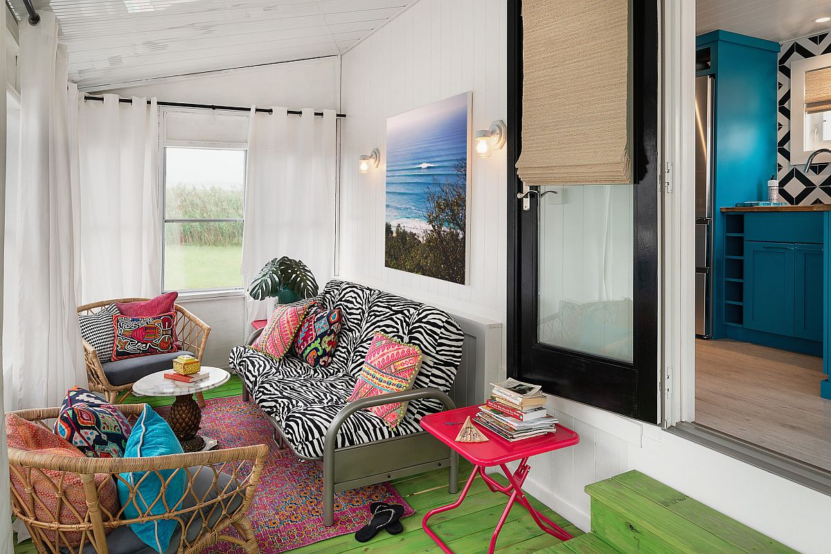 Eclectic mix of colorful decor for the small sunroom with white walls