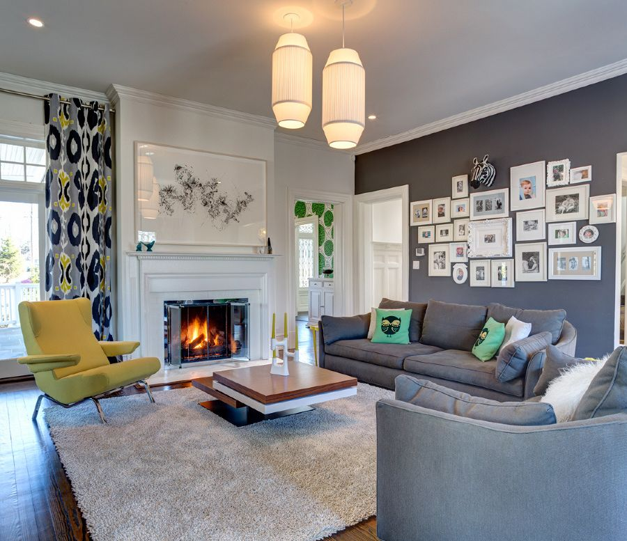 Elegant living room with a dark gray accent wall turned into a lovely gallery wall