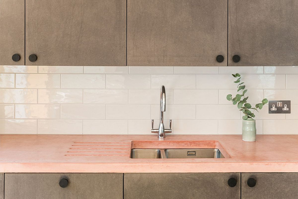 Exquisite modern kitchen with countertop in blush adds pink panache in an understated fashion